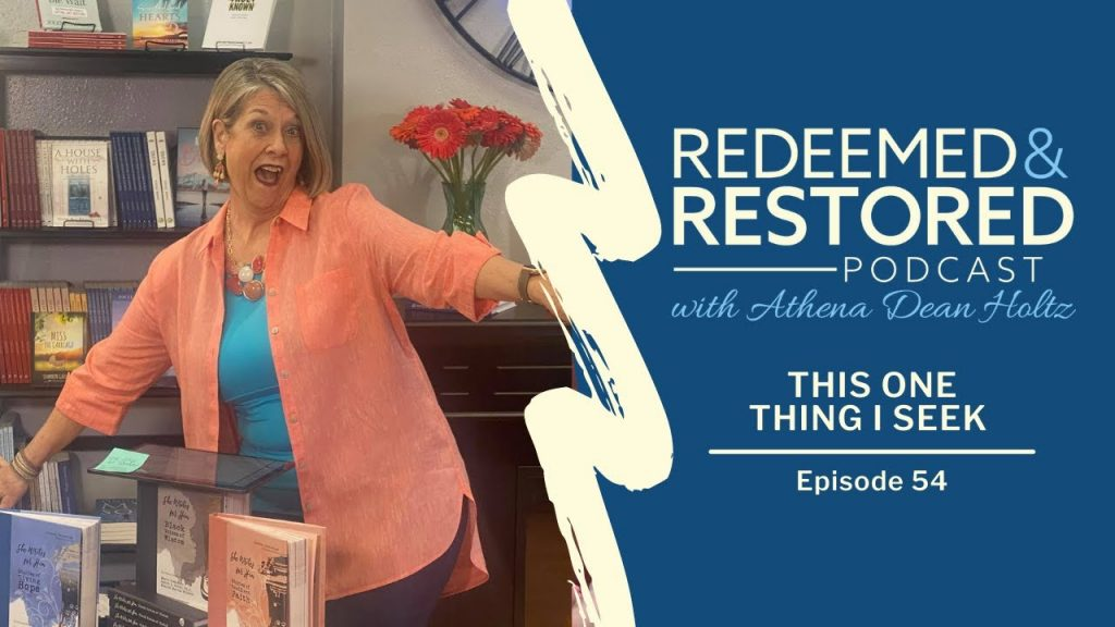 Redeemed and Restored Episode 54: This One Thing I Seek - Athena in front of red daisies, looking thrilled to see you